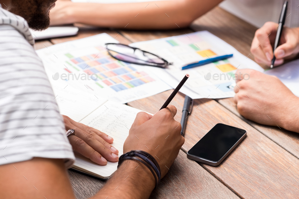 Students writing notes - Stock Photo - Images