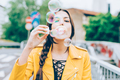 Hipster woman playing with bubble soap - PhotoDune Item for Sale