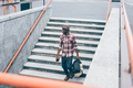 Young handsome afro black man going downstairs - PhotoDune Item for Sale