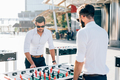 Modern businessman playing table football - PhotoDune Item for Sale