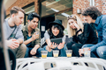 Group of young multiethnic friends sitting in a bar - PhotoDune Item for Sale