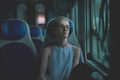 Young beautiful woman sitting on a train - PhotoDune Item for Sale