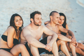 Group of young beautiful multiethnic woman and man friends sunbathing - PhotoDune Item for Sale