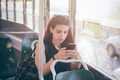 Woman using a smartphone on a tram - PhotoDune Item for Sale