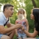 Father, Mother And Daughter In The Park Having Fun - VideoHive Item for Sale