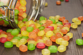toppled over glass jar full of colorful sweets - PhotoDune Item for Sale