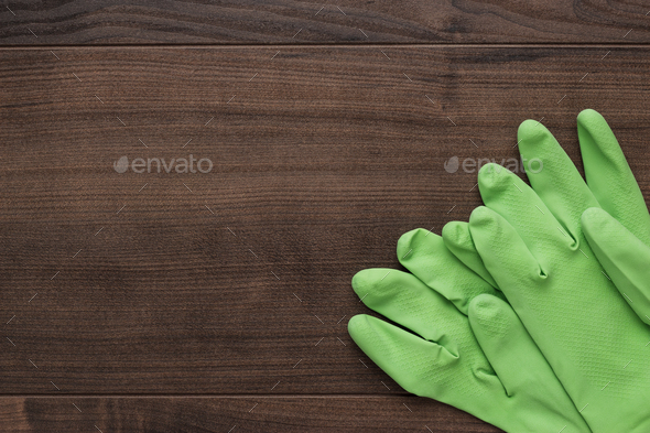green rubber cleaning gloves - Stock Photo - Images