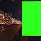 A Billboard with a Green Screen on a Busy Night Street - VideoHive Item for Sale