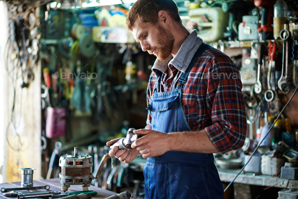 Technician in workshop - Stock Photo - Images