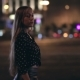 Young Woman Walking Through a Night City Street - VideoHive Item for Sale