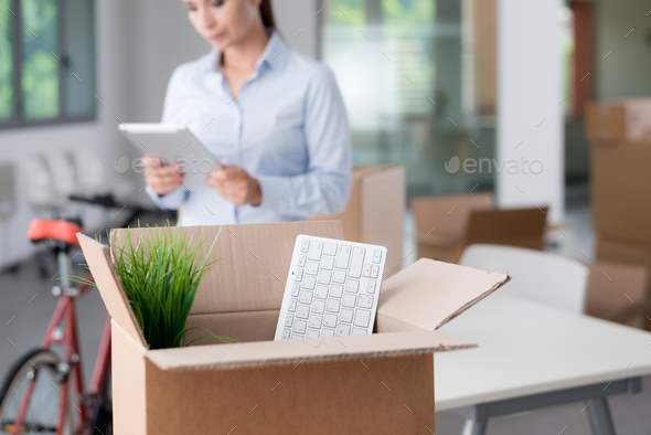 Business woman moving in a new office - Stock Photo - Images