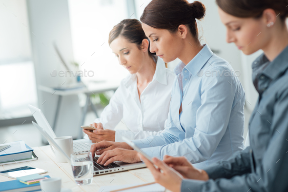 Efficient business women working together - Stock Photo - Images