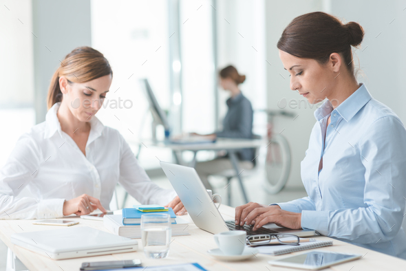 Successful women entrepreneurs at work - Stock Photo - Images