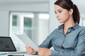 Confident businesswoman using a digital tablet - PhotoDune Item for Sale