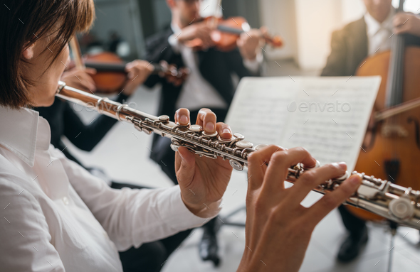 Flutist playing her instrument on stage - Stock Photo - Images