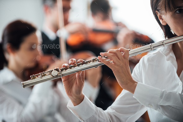 Professional flute player performing - Stock Photo - Images