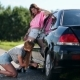 Cute Woman Jacking Up Her Car to Change Flat Tire - VideoHive Item for Sale