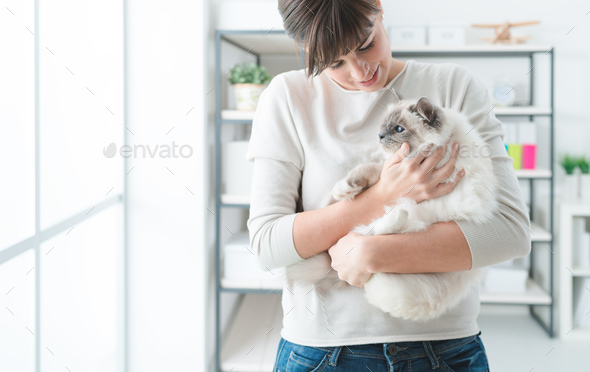 Woman holding her lovely cat - Stock Photo - Images