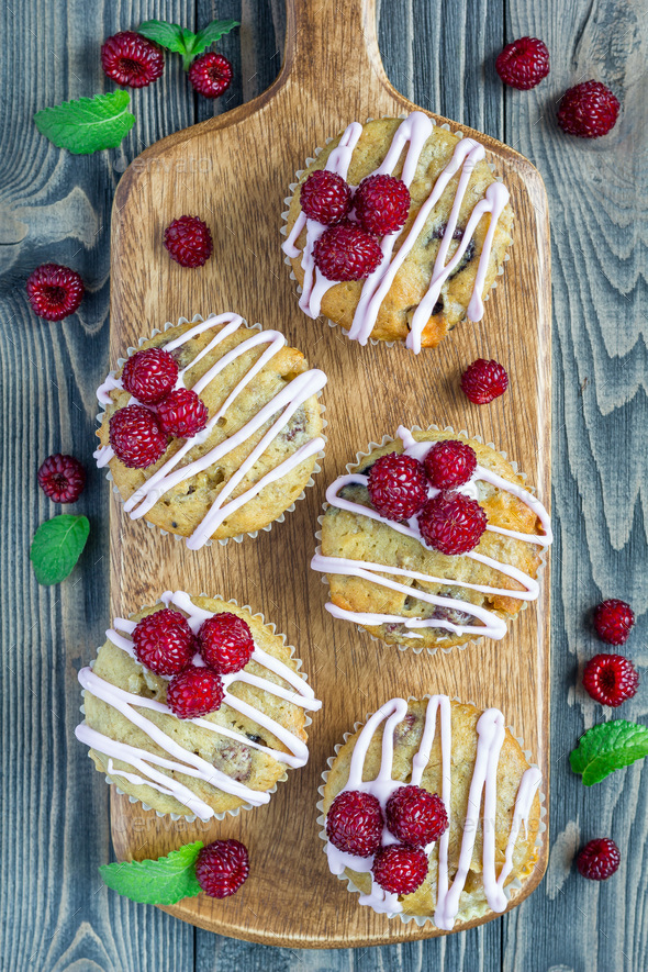Banana bread muffins with raspberries, cherries, white chocolate, top view - Stock Photo - Images
