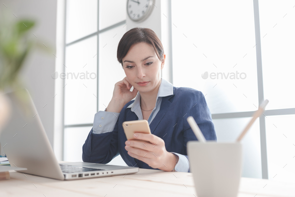 Businesswoman using mobile apps - Stock Photo - Images