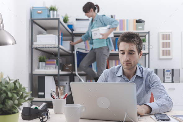 Two people working in the office - Stock Photo - Images