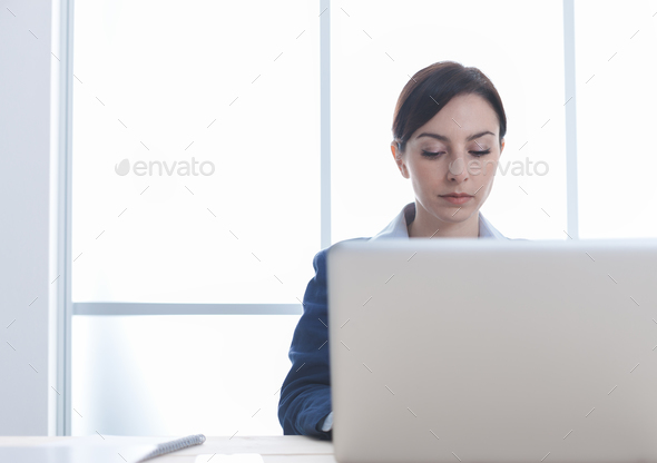Confident businesswoman in the office - Stock Photo - Images