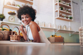Smiling young woman working in a juice bar - PhotoDune Item for Sale