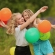Two Girlfriends Best Friends Hugging With Colorful Balls. - VideoHive Item for Sale