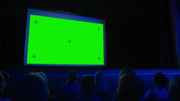 In The Movie Theater Captivated Audience Watching New Blockbuster Film On Mock Up Green Screen By Gorodenkoffs