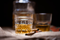 whiskey drink on the rocks with bottle isolated on black - PhotoDune Item for Sale