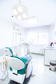 Dentist tools and professional dentistry chair waiting to be used - PhotoDune Item for Sale