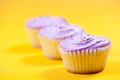 Raspberry muffin with vanilla filling against yellow background - PhotoDune Item for Sale