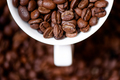 Detail, macro view of coffee mug with aromatic black coffee bean - PhotoDune Item for Sale