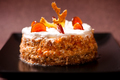 Hazelnut and nuts birthday cake with white chocolate topping - PhotoDune Item for Sale