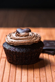 One chocolate muffin stuffed with sweet creamy hazelnut sauce - PhotoDune Item for Sale