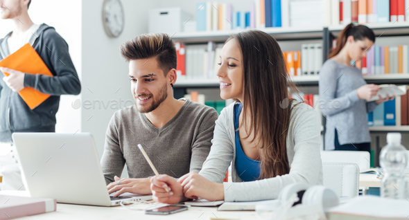 Friends studying together - Stock Photo - Images