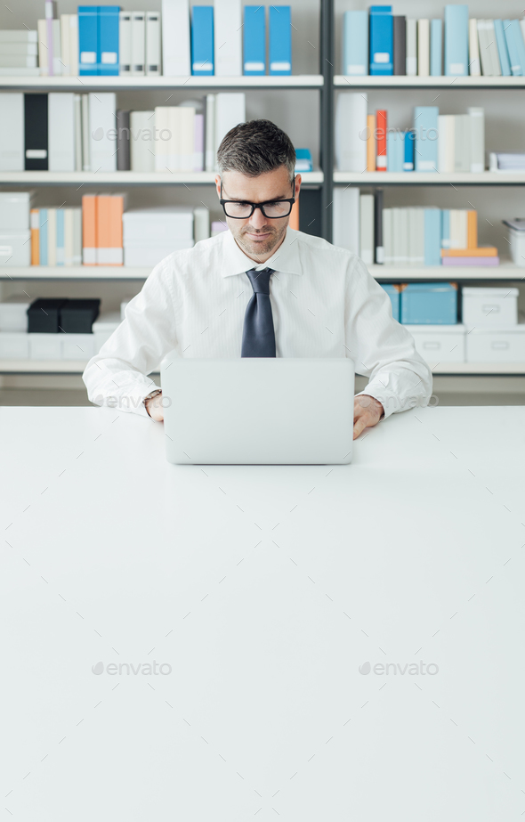 Businessman working with a laptop - Stock Photo - Images
