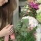 Female Florist Makes a Bouquet Of Flowers At Flower Shop - VideoHive Item for Sale