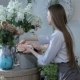 Female Florist Moving Flowers Near The Window At Flower Shop - VideoHive Item for Sale