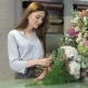 Female Florist Demonstrate a Bouquet Of White Flowers At Flower Shop - VideoHive Item for Sale