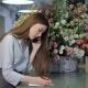 Female Florist Talks On The Phone At Flower Shop - VideoHive Item for Sale