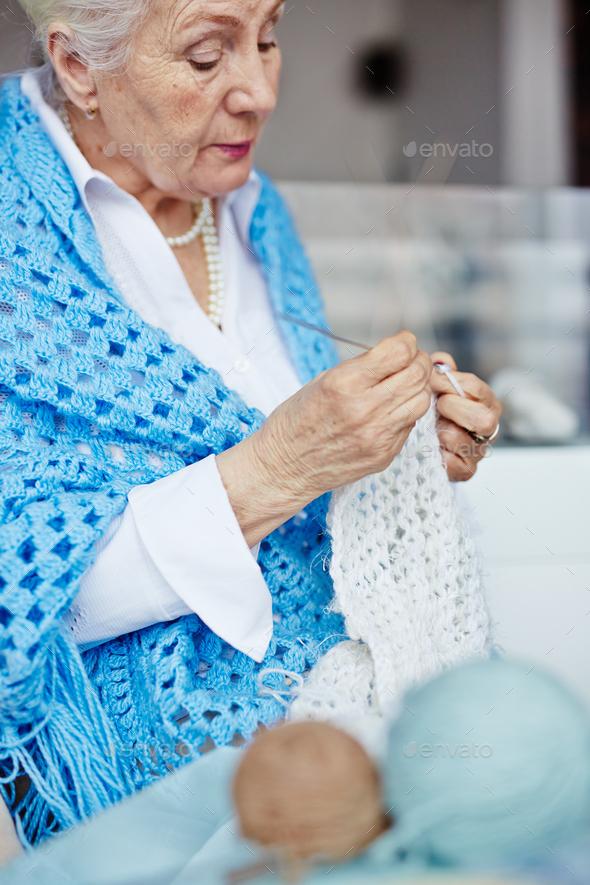Knitting scarf - Stock Photo - Images