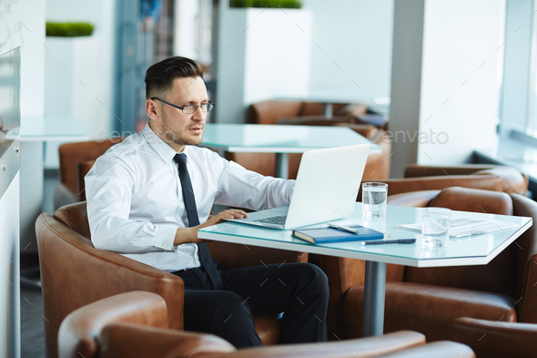 Businessman in cafe - Stock Photo - Images