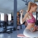Woman Trains On Lat Pull-down Machine At The Fitness Centre - VideoHive Item for Sale