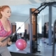 Woman Pulling The Rope Of Gym Machine To Her Thighs At The Fitness Centre - VideoHive Item for Sale
