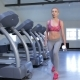 Woman Does Step-up Exercise At The Fitness Centre - VideoHive Item for Sale