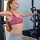 Woman Trains Her Chest Muscles On Pec Deck Machine At The Fitness Centre - VideoHive Item for Sale