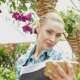 Female Florist Makes Selfie At The Garden Centre - VideoHive Item for Sale