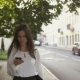 Woman Uses Smartphone Walking In Old City.  - VideoHive Item for Sale