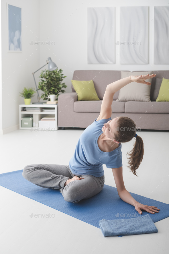 Woman practicing yoga at home - Stock Photo - Images